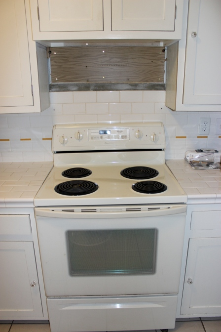 Before: Old stove. When we removed the microwave we saw the backsplash didn't go all the way up so we had to get creative.