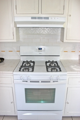 New stove with faux tin backsplash